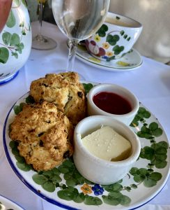 Scones, strawberry jam, butter, pot of butter, crunchy scones, handpainted china