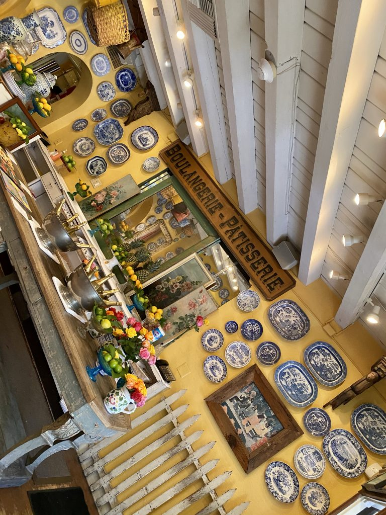 White beamed ceilings, French antiques, blue & white china on yellow walls