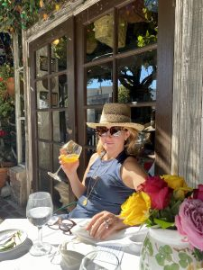 Emily Heston, Splendid Market at The Ivy sipping a mimosa