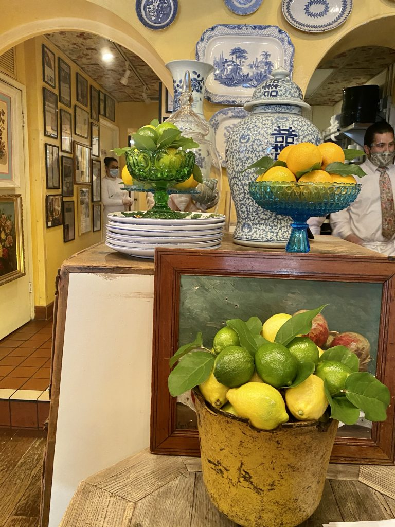 Citrus fruit display, eclectic decor, blue and white china, yellow walls, The Ivy
