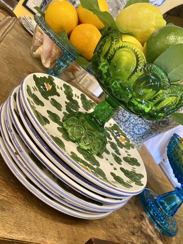Fresh citrus display, hand painted china, glassware, lemons, limes