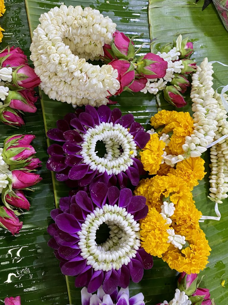 Malai chai diao, orchids, marigolds, roses, jasmine blossoms
