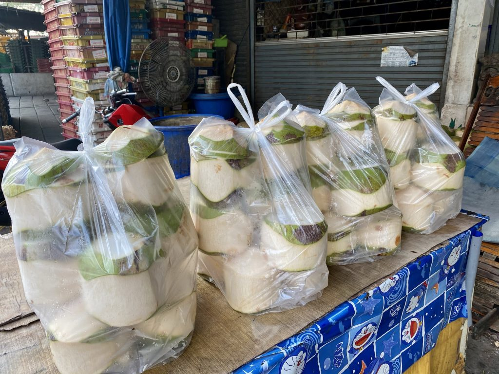 Bags of trimmed coconuts