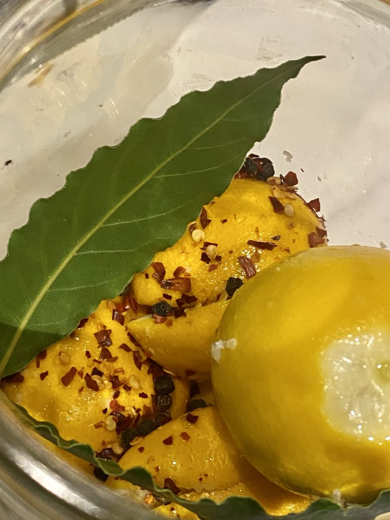 Preserved lemons in a jar, diy preserved lemons, fresh bay leave, red chili flakes, meyers lemons
