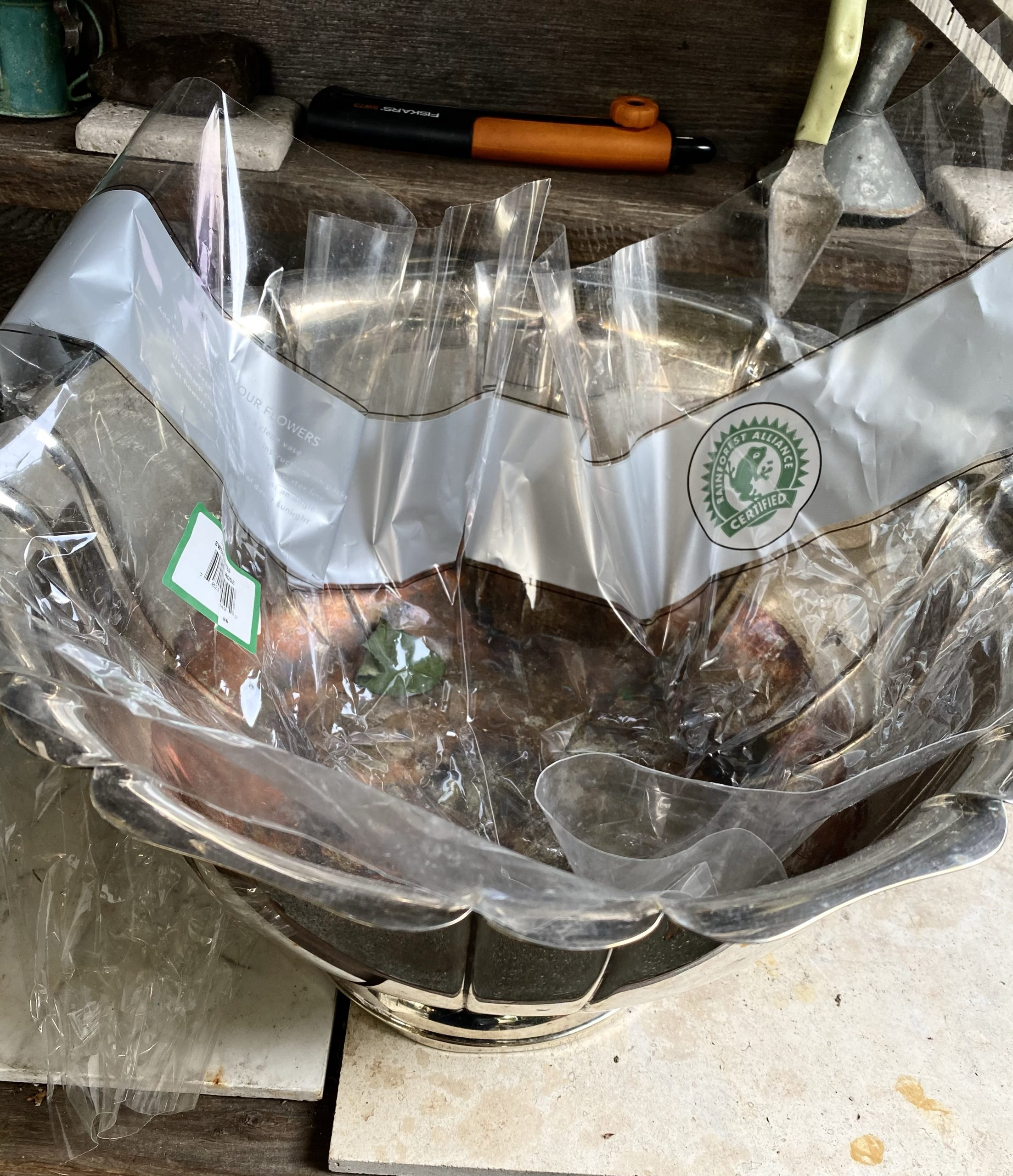 rustic potting table, potting table, silver punch bowl lined with cellophane